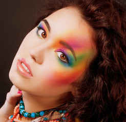 Multicolored Woman's Face. Vibrant Colorful Rainbow Makeup