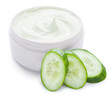Jar of cream and slices of cucumber.