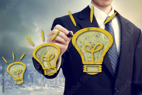 Businness Man with Idea Lightbulbs