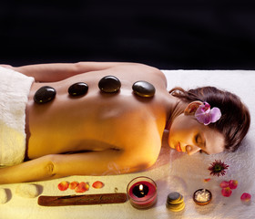 Woman getting stones spa procedures.