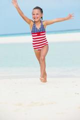 Girl Having Fun In Sea On Beach Holiday
