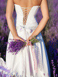 Fototapety Beautiful bride in lavender field at wedding dress