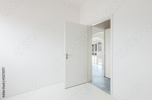 White apartment Interior, open door