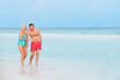 Senior Romantic Couple Walking In Beautiful Tropical Sea