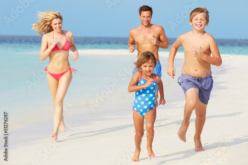 Family Having Fun On Beach Holiday
