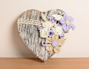 Interior decoration, decorative wooden heart with purple rose.
