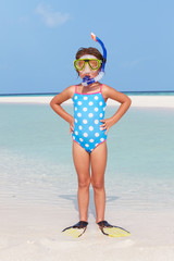Girl Standing On Beach Wearing Snorkel And Flippers