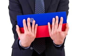 Businessman holding folders.