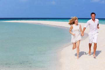 Romantic Couple Running On Beautiful Tropical Beach