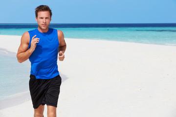 Man Running On Beautiful Beach