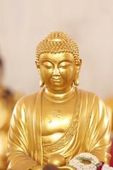 The gold Buddhist saint.