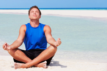 Man Meditating On Beautiful Beach
