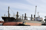 Cargo ship moored to port in the winter time