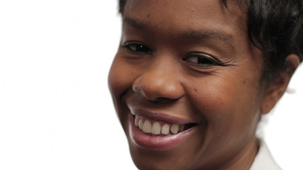 Close up of African American woman's face, happy