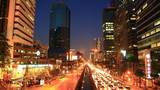 Bangkok traffic at dusk to night , time lapse