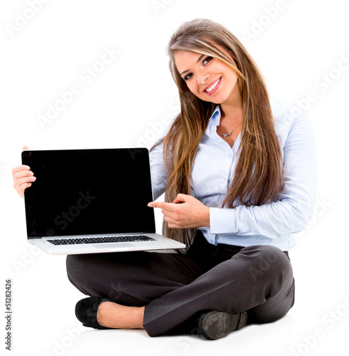 Business woman pointing on a laptop