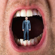 Businessman in open mouth