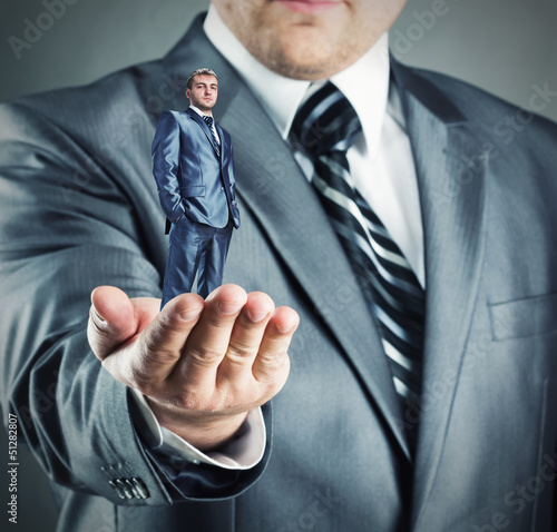 Small businessman in hand