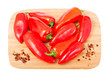 Heart shape made of red hot peppers isolated on white background