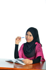 Muslim female student with notebook and pen