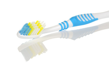 Blue and White Toothbrush with Reflection on White Background