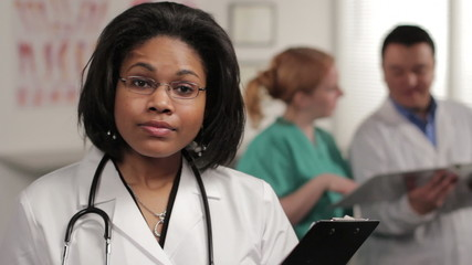 Confident female doctor looking at camera