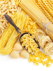 assortment of uncooked pasta on white
