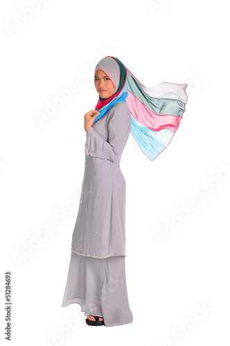 Muslim woman in modern clothes, isolated on white