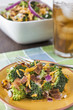 Broccoli salad served with iced tea