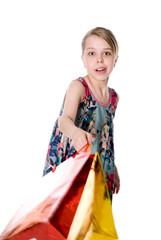 Girl waving a shopping bag.