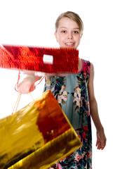 Shopper woman holding shopping bags.