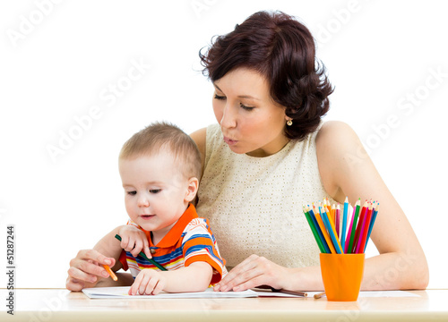 baby boy and mother drawing with colorful pencils