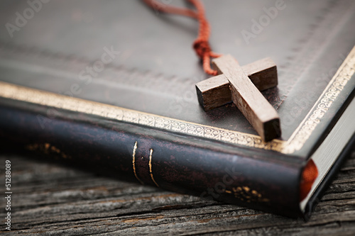 Cross on Bible