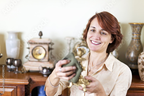 Woman polishing antiques