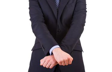 Businessman showing jail gesture with his hands.