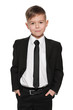 Handsome young boy in black suit