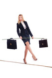 Businesswoman walking on tight rope isolated
