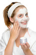 Applying face mask fingers smiling blonde girl