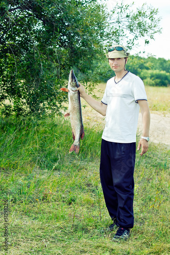 Fisherman Holding Large Pike