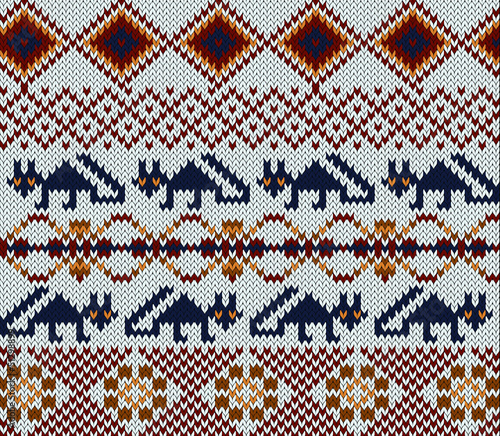 Knitted swatch in folk style with stylized foxes