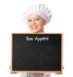 Female chef/ baker holding a menu blackboard for notes. Isolated