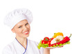 Happy smiling chef with a dish of healthy food . Isolated