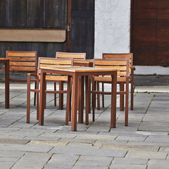 Spring tables and chairs beeing alone in Venice