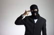 criminale con maschera e pistola (suicidio)