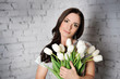 Beautiful woman with white tulips