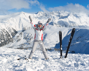 Cheerful skier on the top of Pirin mountains