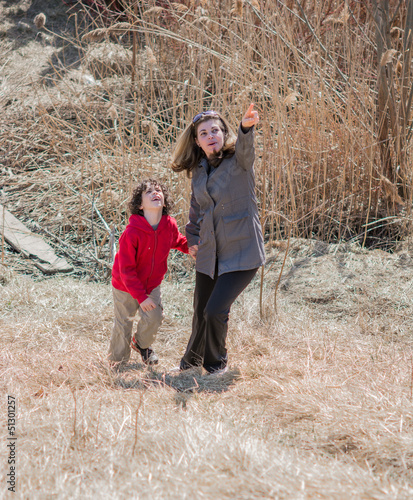 Hispanic Mother Guiding Her Son Through the Wilderness