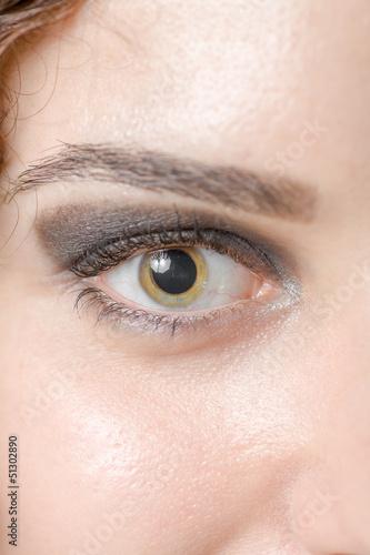 Macro shot of woman's eye with long eyelashes sensual look
