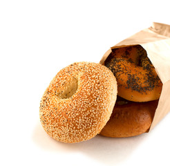 Assorted bagels in brown paper bag