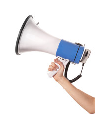 A woman is holding a loudspeaker